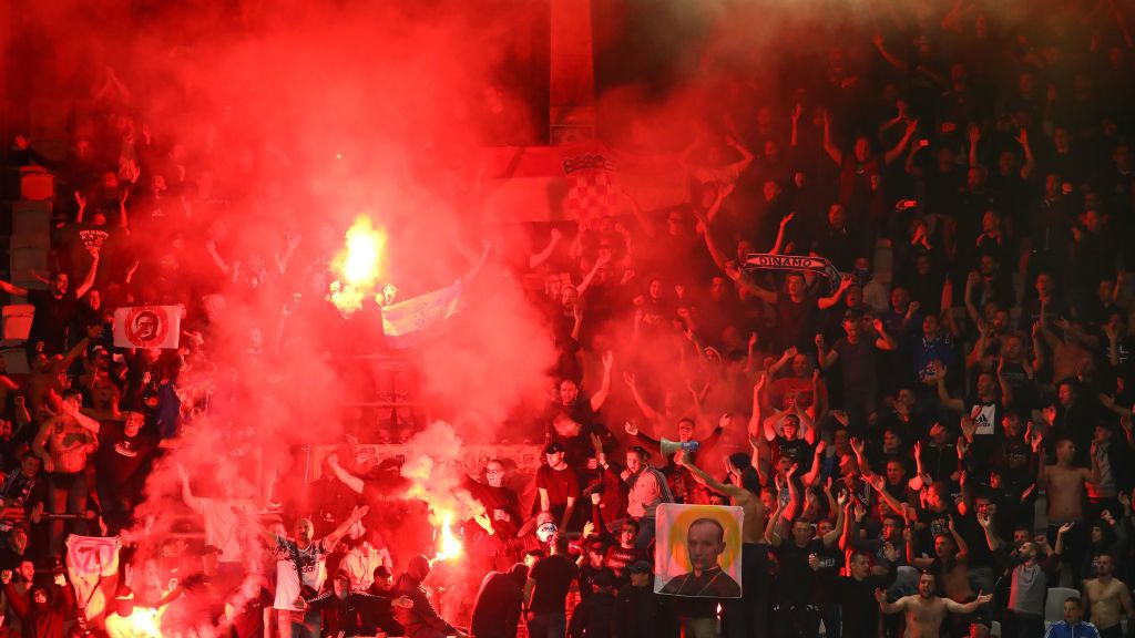 BRUSSELS, BELGIUM - OCTOBER 04:  Fans light flares during the UEFA Europa League Group D match between RSC Anderlecht and Dinamo Zagreb at Constant Vanden Stock Stadium on October 4, 2018 in Brussels, Belgium.  (Photo by Dean Mouhtaropoulos/Getty Images)