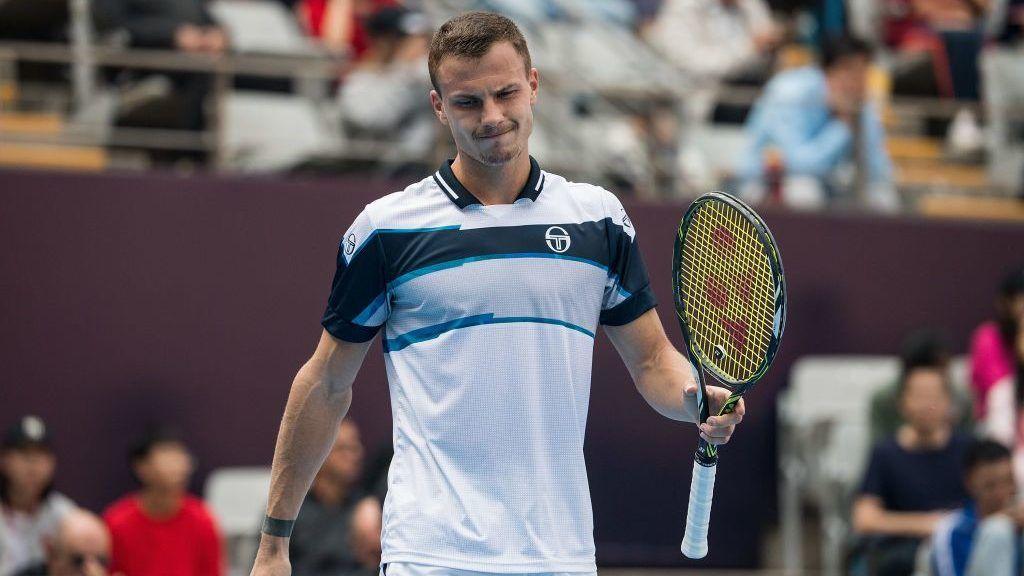 BEIJING, CHINA - OCTOBER 05:  Marton Fucsovics of Hungary reacts during his men's 1/4 final match against Fabio Fognini of Italy of 2018 China Open at the China National Tennis Center on October 5, 2018 in Beijing, China.  (Photo by Di Yin/Getty Images)