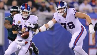 EAST RUTHERFORD, NJ - OCTOBER 11:  Eli Manning #10 of the New York Giants fumbles the ball after a hit by Michael Bennett #77 of the Philadelphia Eagles during the first quarter at MetLife Stadium on October 11, 2018 in East Rutherford, New Jersey. Nate Solder #76 of the New York Giants recovered the fumble on the 1 yard line.  (Photo by Elsa/Getty Images)