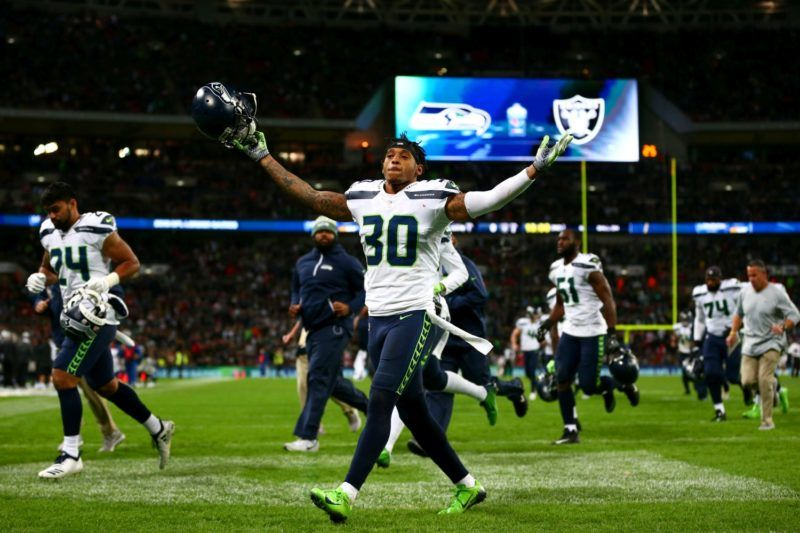 LONDON, ENGLAND - OCTOBER 14:  Bradley McDougald #30 of the Seattle Seahawks reacts in front of the fans at half-time during the NFL International Series game between Seattle Seahawks and Oakland Raiders at Wembley Stadium on October 14, 2018 in London, England.  (Photo by Dan Istitene/Getty Images)