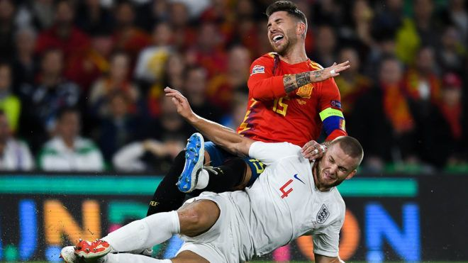 SEVILLE, SPAIN - OCTOBER 15:  Sergio Ramos of Spain is challenged by Eric Dier of England during the UEFA Nations League A group four match between Spain and England at Estadio Benito Villamarin on October 15, 2018 in Seville, Spain.  (Photo by David Ramos/Getty Images)