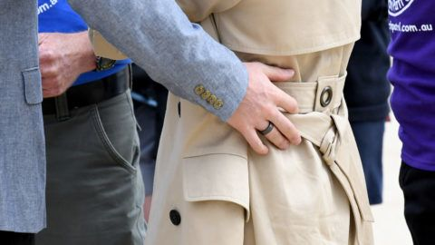 MELBOURNE, AUSTRALIA - OCTOBER 18:  Prince Harry, Duke of Sussex wearing a new black metallic ring as he puts his hand on his wife Megan, Duchess of Sussex on October 18, 2018 in Melbourne, Australia. The Duke and Duchess of Sussex are on their official 16-day Autumn tour visiting cities in Australia, Fiji, Tonga and New Zealand.  (Photo by James D. Morgan/WireImage)