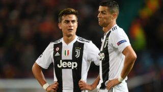 MANCHESTER, ENGLAND - OCTOBER 23:  Paulo Dybala of Juventus speaks with Cristiano Ronaldo of Juventus during the Group H match of the UEFA Champions League between Manchester United and Juventus at Old Trafford on October 23, 2018 in Manchester, United Kingdom.  (Photo by Michael Regan/Getty Images)