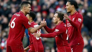 LIVERPOOL, ENGLAND - OCTOBER 27:  Xherdan Shaqiri of Liverpool celebrates with teammates after scoring his team's third goal during the Premier League match between Liverpool FC and Cardiff City at Anfield on October 27, 2018 in Liverpool, United Kingdom.  (Photo by Jan Kruger/Getty Images)