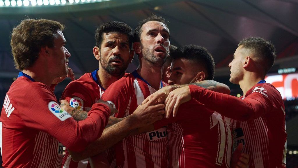 MADRID, SPAIN - OCTOBER 27:  Diego Roberto Godin of Atletico de Madrid celebrates after scoring his sides first goal with his temmates Angel Correa and Diego Costa, Antoine Griezmann (L) and Lucas Hernandez (R) during the La Liga match between Club Atletico de Madrid and Real Sociedad at Wanda Metropolitano on October 27, 2018 in Madrid, Spain.  (Photo by Quality Sport Images/Getty Images)