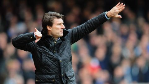 LONDON, ENGLAND - FEBRUARY 01:  Michael Laudrup manager of Swansea City signals during the Barclays Premier League match between West Ham United and Swansea City at Boleyn Ground on February 1, 2014 in London, England.  (Photo by Mike Hewitt/Getty Images)