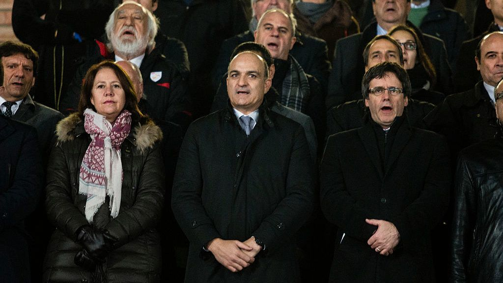 The president of Catalonia Puigdemont with Neus Munte and Andreu Subies during the friendly football match between the selections of Catalonia vs Tunisia atthe stadium Municipal de Montilivi in Girona on December 28th of 2016, Spain. (Photo by Xavier Bonilla/NurPhoto via Getty Images)