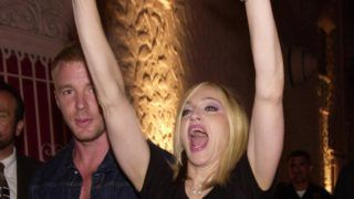 """378684 03: Singer/actress Madonna and boyfriend Guy Ritchie react to fans at a launch party for her new album """"Music"""" September 19, 2000 in Los Angeles, CA. (Photo by Chris Weeks/Liaison)"""