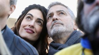 WASHINGTON, DC - MARCH 24:  Amal Clooney and George Clooney attend March For Our Lives on March 24, 2018 in Washington, DC.  (Photo by Paul Morigi/Getty Images for March For Our Lives)