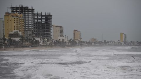"""General view of the Malecon (boardwalk) in Mazatlan, Sinaloa state, Mexico, on October 22, 2018, before the arrival of Hurricane Willa. - Hurricane Willa was upgraded to a """"potentially catastrophic"""" Category 5 storm Monday off Mexico's Pacific coast, where it was expected to produce life-threatening wind and flooding, the US National Hurricane Center said. (Photo by ALFREDO ESTRELLA / AFP)"""
