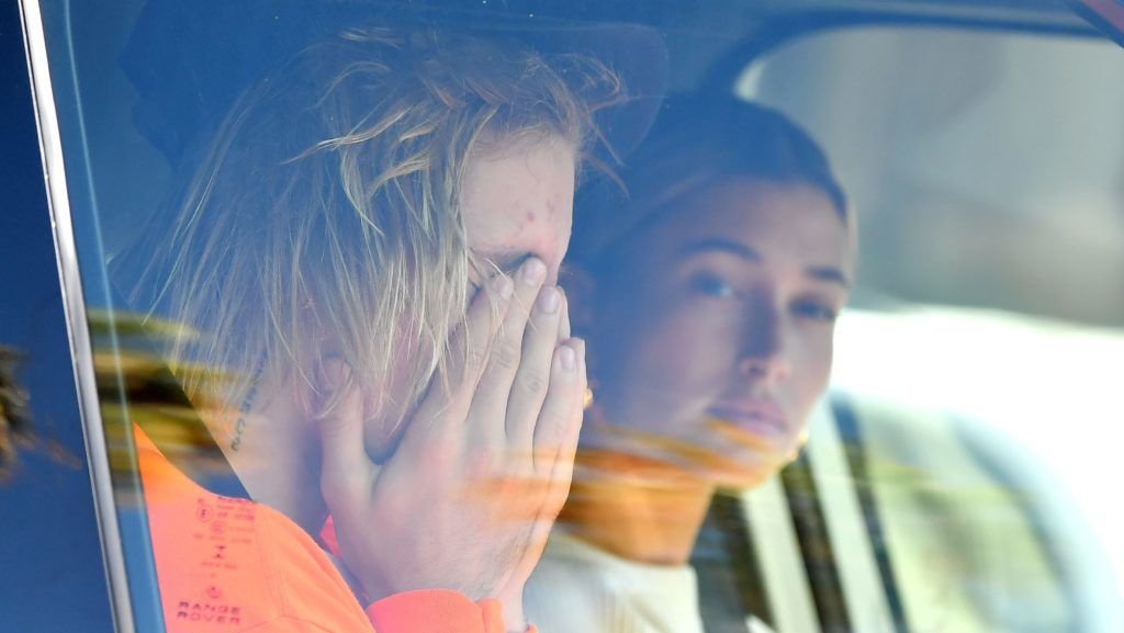 Justin Bieber looks worse for wear as he and Hailey Baldwin drive to their Pastor's house in Beverly Hills. Justin Appears to be crying. 11 Oct 2018 Pictured: Justin Bieber and Hailey Baldwin. Photo credit: Snorlax / MEGA  TheMegaAgency.com +1 888 505 6342 October 11, 2018  *** Local Caption *** MEGA290863_004