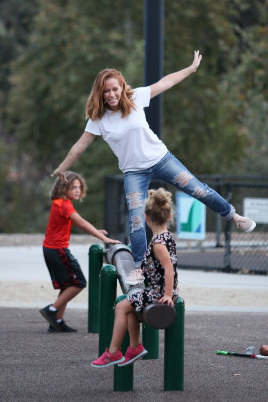 EXCLUSIVE: Kendra Wilkinson played with her kids Alijah and Hank Baskett at the playground park which included many activities such as hockey, tag, climbing the slide, balancing, and swinging. Kendra was wearing a white t-shirt, ripped denim jeans, and showed off her new shoes while holding a toy baby and a hockey stick. 22 Oct 2018 Pictured: Kendra Wilkinson, Alijah Baskett, Hank Baskett. Photo credit: MEGA  TheMegaAgency.com +1 888 505 6342 October  , 2018 *** Local Caption *** MEGA296655_001