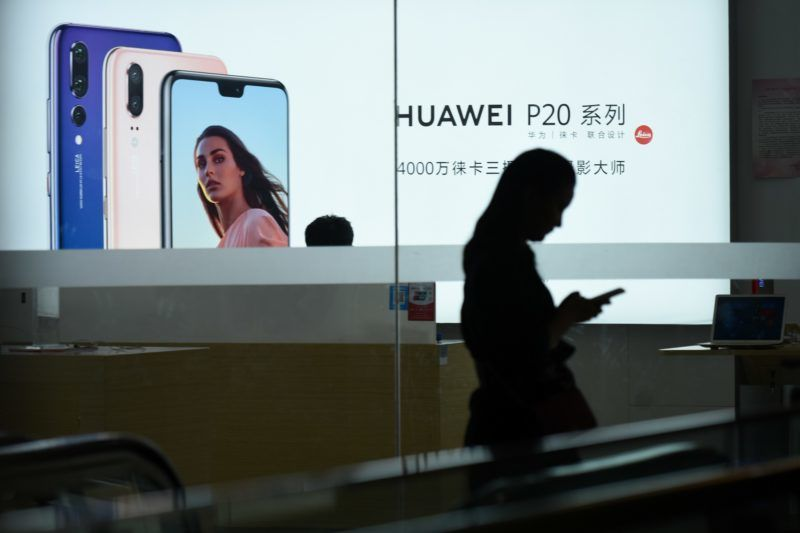 A Huawei poster is displayed in a Huawei store in Beijing on August 7, 2018. - Despite being essentially barred from the critical US market, Huawei surpassed Apple to become the world's number two smartphone maker in the second quarter of this year and has market leader Samsung in its sights. Huawei has achieved this in part by refocusing away from the futile fight for US access and toward gobbling up market share in developing nations with its moderately priced but increasingly sophisticated phones, analysts said. (Photo by WANG ZHAO / AFP) / TO GO WITH China-telecommunication-Huawei-mobile-Samsung-Apple,FOCUS by Dan Martin