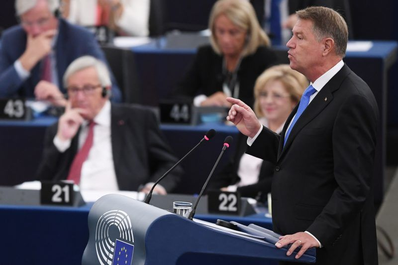 Romania's President Klaus Werner Iohannis speaks next to Jean-Claude Juncker (back left) during a debate on the future of Europe at the European Parliament on October 23, 2018 in Strasbourg, eastern France. (Photo by FREDERICK FLORIN / AFP)