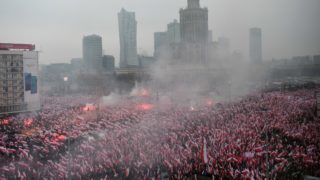"""People attend the """"March of Independence"""" on November 11, 2018 in Warsaw to mark 100 years of Polish independence. (Photo by Janek SKARZYNSKI / AFP)"""