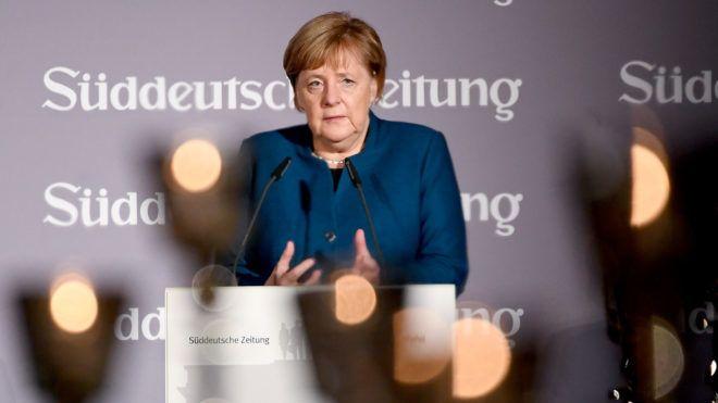 German Chancellor Angela Merkel speaks at the economic forum organised by German daily newspaper Sueddeutsche Zeitung on November 13, 2018 in Berlin. (Photo by Britta Pedersen / dpa / AFP) / Germany OUT