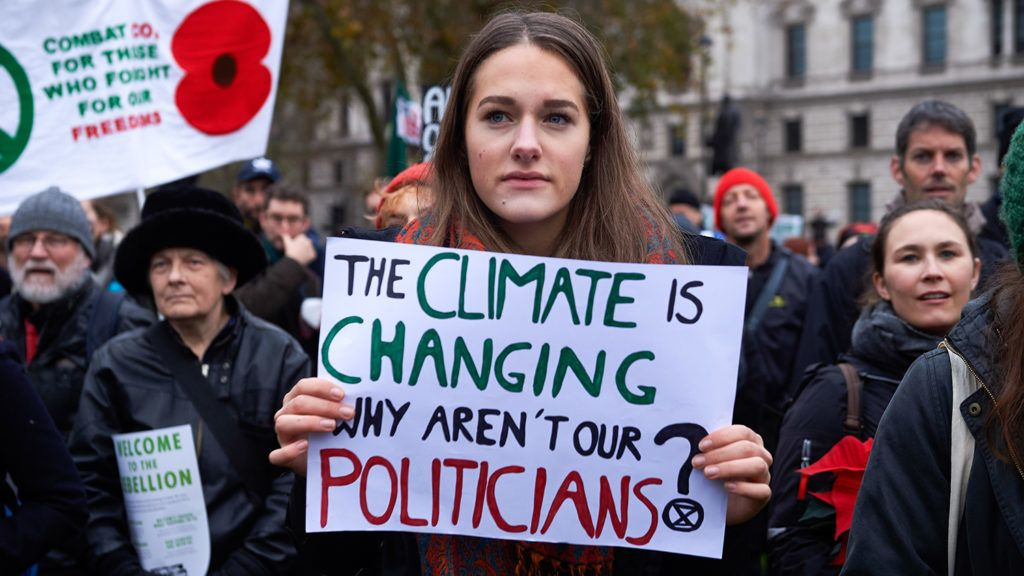 Environmental activists march during a demonstration organised by the movement Extinction Rebellion in central London on November 24, 2018, calling on the British government to take action on climate and ecological issues. - After a week of protest action disrupting the traffic on bridges in central London over the Thames, the social movement Extinction Rebellion, plans what is dubbed a 'funeral march' to highlight what they describe as a climate and ecological emergency. Extinction Rebellion demands that the UK government reduces to net zero greenhouse gas emissions by 2025 and creates a citizen's assembly to oversee changes in environmental policies. (Photo by Niklas HALLE'N / AFP)