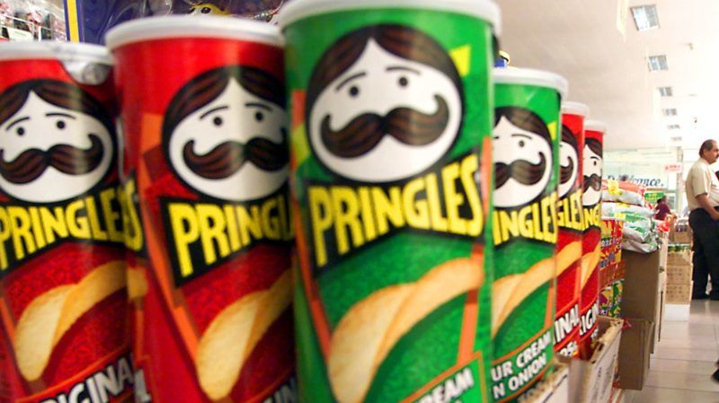 American-made Pringles, which are very popular in China, line the isle of the imported goods section of a grocery store as a Chinese woman shops 20 September 2000 in downtown Beijing.  The US Senate voted Tuesday to permanently normalize trade with China by passing a historic trade bill that President Clinton says will promote prosperity in America and freedom in China.     (ELECTRONIC IMAGE)       AFP PHOTO/Stephen SHAVER (Photo by STEPHEN SHAVER / AFP)