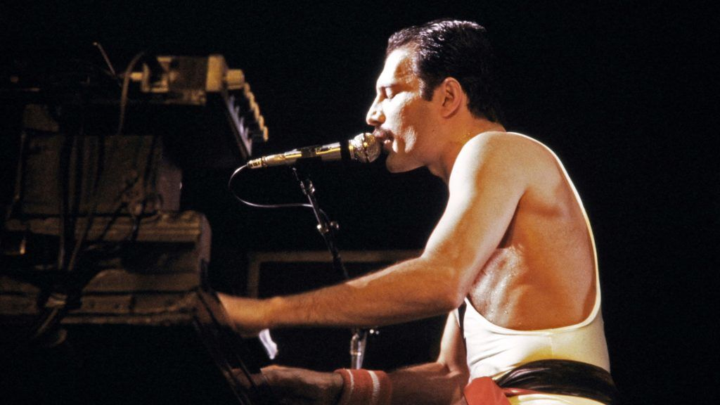 """A file picture taken on September 18, 1984 showing Rock star Freddie Mercury, lead singer of the rock group """"Queen"""", during a concert at the Palais Omnisports de Paris Bercy (POPB). (Photo by JEAN-CLAUDE COUTAUSSE / AFP)"""