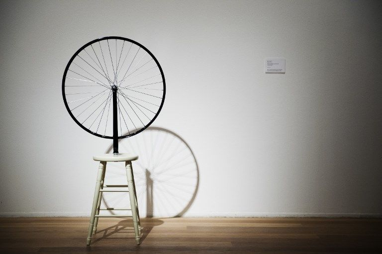 """A picture taken on August 23, 2012 shows the art work """"Bicycle Wheel"""" by French artist Marcel Duchamp during the Picasso/Duchamp """"He was wrong"""" exhibition at the Moderna Museet in Stockholm. In the exhibition Picasso/Duchamp """"He was wrong"""", Moderna Museet in Stockholm is exhibiting the two giants Pablo Picasso and Marcel Duchamp together for the first time. This exhibition runs from August 25, 2012 to March 3, 2013. AFP PHOTO/JONATHAN NACKSTRAND RESTRICTED TO EDITORIAL USE, MANDATORY MENTION OF THE ARTIST UPON PUBLICATION, TO ILLUSTRATE THE EVENT AS SPECIFIED IN THE CAPTION (Photo by JONATHAN NACKSTRAND / AFP)"""