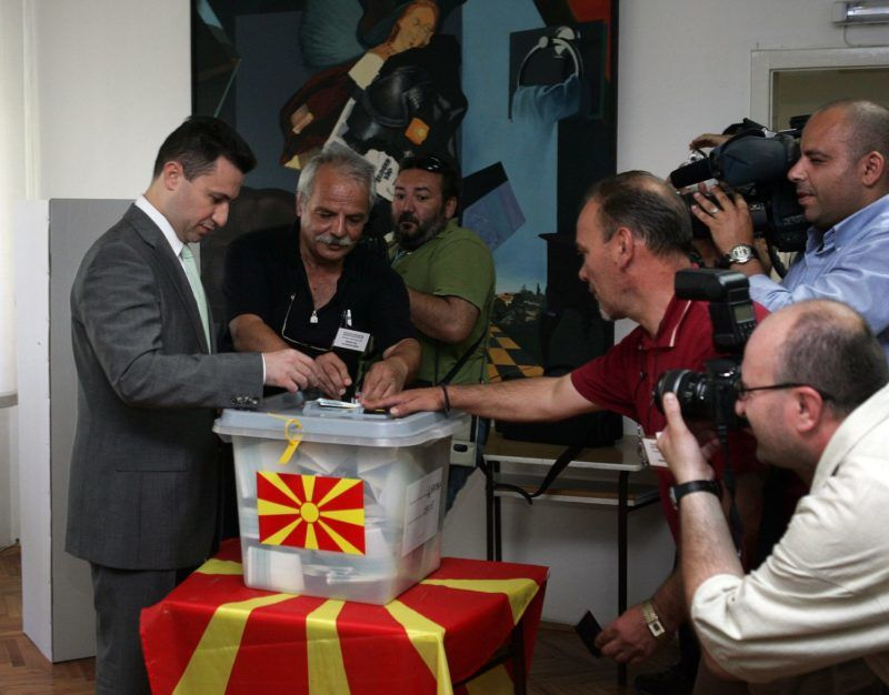 The leader of the biggest opposition party, VMRO-DPMNE (Internal Macedonian Revolutionary Party - Democratic Party for Macedonian National Unity) Nikola Gruevski (L) prepares to cast his ballot at a polling station in Skopje, 05 July 2006. Macedonians are voting in a general election seen as a crucial test of democracy in the impoverished Balkan country as it bids for European Union and NATO integration.      AFP PHOTO / DIMITAR DILKOFF (Photo by DIMITAR DILKOFF / AFP)