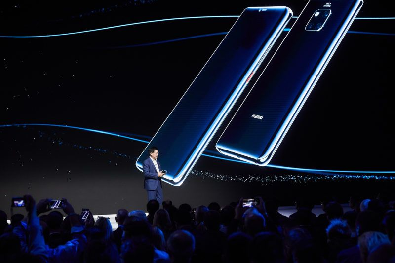 """In this handout picture, Richard Yu Chengdong, chief executive of Huawei's consumer business group, speaks to introduces the Huawei Mate 20 series smartphones at the global launch event in London, UK, 16 October 2018.   With its curved 2.5D glass screen, super slim profile and beautifully sleek curvature encasing the world's first 7nm smartphone chipset, Huawei's Mate 20 series – comprising the Mate 20, Mate 20 Pro and the Porsche Design Mate20 RS – flaunted both beauty and brains at the global launch event held in London on Tuesday (Oct 16). Richard Yu, Huawei's CEO said in his keynote address: """"The Mate 20 series combines excellent design, ultimate performance and remarkable photography,"""" said Yu. """"Inspired by desire."""" When Yu introduced the Twilight Mate 20 Pro in particular, with its navy to pink to black gradation, it drew applause from the full-house media crowd of about 1,800."""