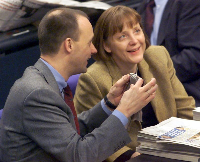 German opposition Christian Democratic Union (CDU) Secretary General Angela Merkel (R) and CDU tax expert Friedrich Merz share a laugh during the tax debate in the German parliament in Berlin, 18 February 2000.  Merz, currently deputy chief of the Christian Democrat Union parliamentary group, is tipped to become the new group leader after current leader Wolfgang Schaeuble announced his resignation on Wednesday.