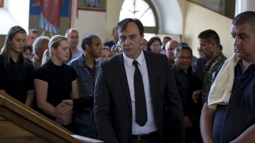 Saso Mijalkov (C), the head of Macedonian counter-intelligence, is seen during the funeral of killed policeman Sasho Samoilovski inside a church in the town of Tetovo, Macedonia May 10, 2015. Macedonia's embattled prime minister removed his interior minister and head of counter-intelligence on Tuesday, the state news agency MIA reported, in what appeared to be a major concession to the opposition over a damaging surveillance scandal. Picture taken May 10, 2015. REUTERS/Marko Djurica