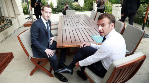"""Facebook's CEO Mark Zuckerberg (L) meets with French President Emmanuel Macron (R) at the Elysee presidential palace following the """"Tech for Good"""" summit in Paris on May 23, 2018. (Photo by Christophe Petit Tesson / POOL / AFP)"""