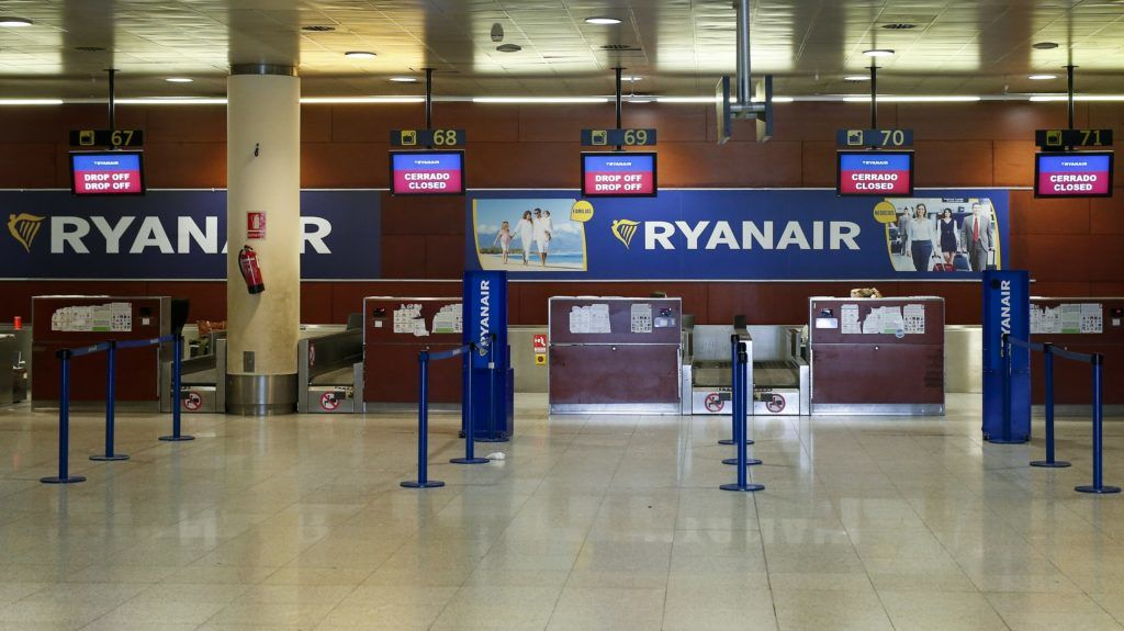 Picture shows closed check-in counters of Irish airline Ryanair at Barcelona's El Prat airport on September 28, 2018. - Ryanair cancelled scores of European flights today as unions staged what they warned could be the biggest strike in the airline's history. The Dublin-based carrier has played down fears of widespread disruption but confirmed it would cancel nearly 250 flights. (Photo by PAU BARRENA / AFP)