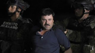 """(FILES) In this file photo taken on January 8, 2016, Drug kingpin Joaquin """"El Chapo"""" Guzman is escorted into a helicopter at Mexico City's airport, following his recapture during an intense military operation in Los Mochis, in Sinaloa State. - Joaquin """"El Chapo"""" Guzman goes on trial in New York on November 5, 2018 accused of running the world's biggest drug cartel and spending a quarter of a century smuggling more than 155 tons of cocaine into the United States. (Photo by ALFREDO ESTRELLA / AFP)"""