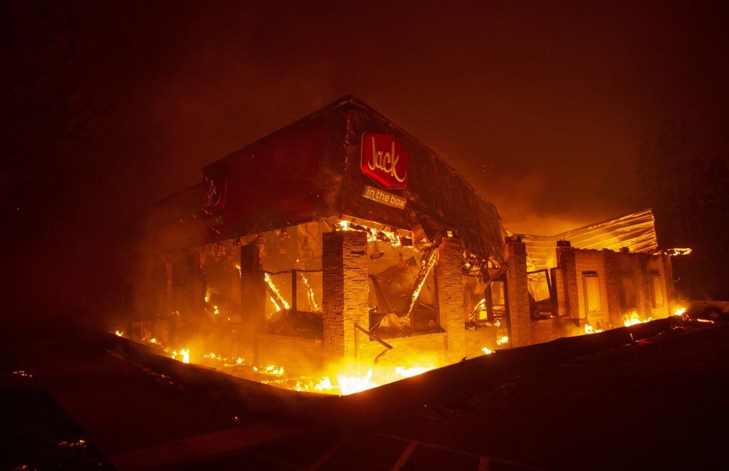 A Jack In The Box fast food restaurant burns as the Camp fire tears through Paradise, north of Sacramento, California on November 08, 2018. - More than one hundred homes, a hospital, a Safeway store and scores of other structures have burned in the area and the fire shows no signs of slowing. (Photo by Josh Edelson / AFP)