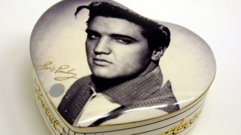 """(FILES) In this file photo taken on August 30, 2001, shows a box bearing a portrait of US singer Elvis Presley is displayed at the International Museum of Modest Arts of Sete, southern France. - Music legend Elvis Presley, baseball great Babe Ruth and late Supreme Court justice Antonin Scalia are among seven people who will be honored with the Presidential Medal of Freedom, the White House said on November 10, 2018. The award is the country's highest civilian honor, and recognizes """"meritorious contributions to the security or national interests of the US, to world peace, or to cultural or other significant public or private endeavors,"""" the White House said in a statement. (Photo by Dominique FAGET / AFP)"""