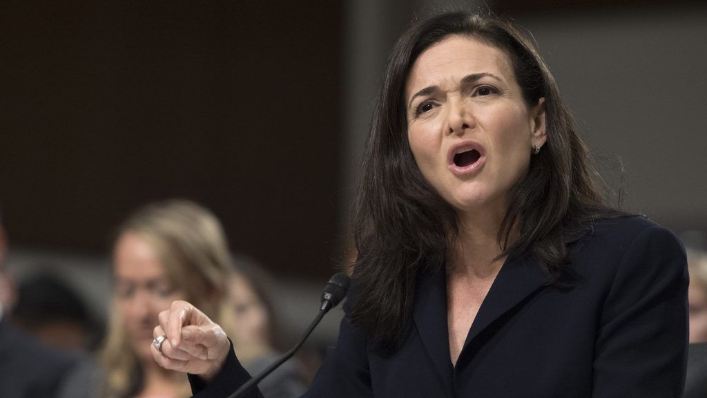 """(FILES) In this file photo taken on September 5, 2018, Facebook COO Sheryl Sandberg testifies before the Senate Intelligence Committee on Capitol Hill in Washington, DC. - Sandberg on on November 16, 2018, pledged a """"thorough"""" review of a political consulting firm's work for the social network giant after one target criticized the techniques used as """"black ops."""" Like founder Mark Zuckerberg, Sandberg has said she was unaware her firm was working with Definers Public Affairs, a Republican opposition research group. (Photo by Jim WATSON / AFP)"""
