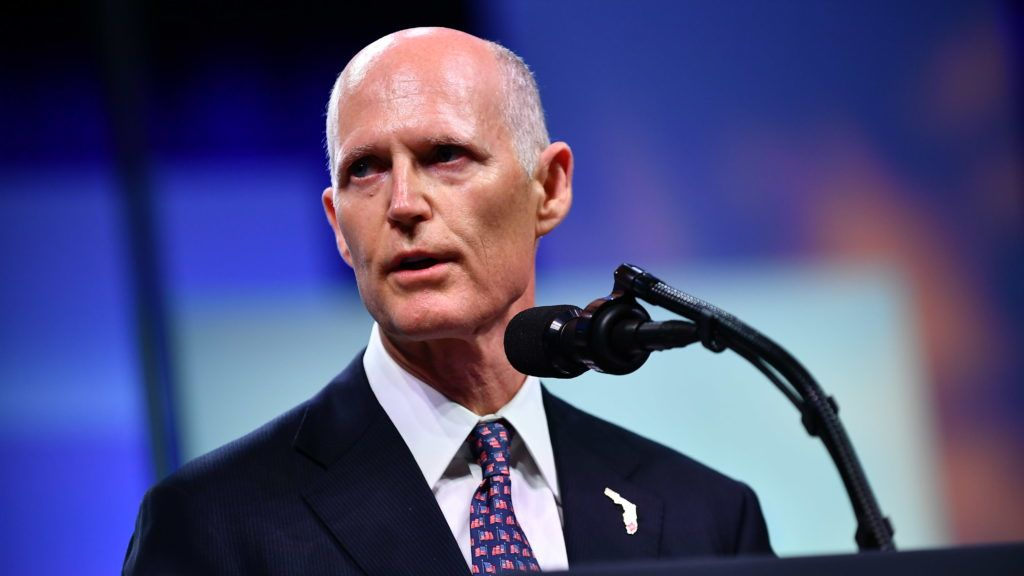 (FILES) In this file photo taken on October 8, 2018, Florida Governor Rick Scott addresses the Chiefs of Police (IACP) annual convention at the Orange County Convention Center in Orlando, Florida. - Florida's outgoing Republican Governor Rick Scott narrowly won a Senate seat in a bitterly contested race with incumbent Bill Nelson, official results showed November 18, 2018. Official final results from the Florida Division of Elections showed Scott barely edged Nelson at 50.05 percent against 49.93 percent, just over 10,000 votes. (Photo by MANDEL NGAN / AFP)