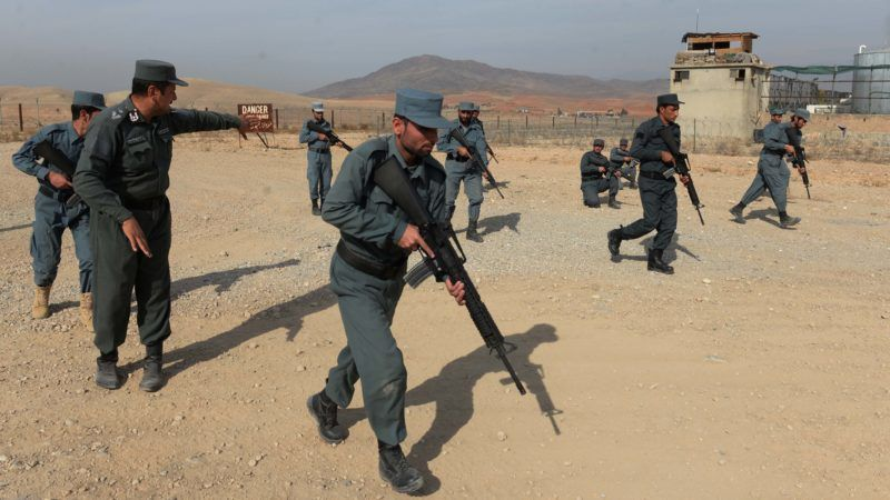 In this photo taken on November 21, 2018, Afghan policemen display their skills at a police training center on the outskirts of Jalalabad in Nangarhar province. - Since the start of 2015, when local forces took over from US-led NATO combat troops to secure the country, nearly 30,000 Afghan soldiers and police have been killed, President Ashraf Ghani revealed this month -- a figure far higher than anything previously acknowledged. (Photo by NOORULLAH SHIRZADA / AFP) / TO GO WITH AFP STORY AFGHANISTAN-UNREST,FOCUS BY ALLISON JACKSON