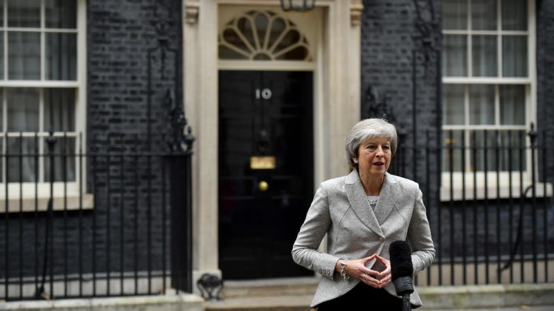 """Britain's Prime Minister Theresa May gives a statement outside 10 Downing Street in central London on November 22, 2018, following the announcement of a draft deal on post-Brexit trade ties with the EU. - British Prime Minister Theresa May was briefing her cabinet on a draft deal on post-Brexit trade ties with the EU before making a statement to MPs on Thursday afternoon, officials said. """"The prime minister will be making a statement to the House (of Commons) later today,"""" leader of the House of Commons Andrea Leadsom said earlier Thursday, after the deal was announced in Brussels. (Photo by Ben STANSALL / AFP)"""