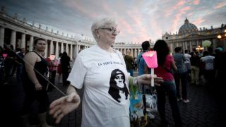 A demonstrator holds a candle during a commemoration of the 30th anniversary of Emanuela Orlandi disappearance in St Peter's Square at the Vatican on June 22, 2013. Fifteen-year-old Emanuela Orlandi, the daughter of a Vatican messenger who lived with his family in Vatican City, disappeared June 22, 1983 when she went to a music lesson. The still unsolved Orlandi saw over the years a number of theories regarding the motives for the crime from claimes that the kidnapping was done by extremist Muslim terrorists to demand the release of Mehmet Ali Agca from prison after he shot pope John Paul II to latest exorcist Gabriele Amorth claiming that she was kidnapped by a member of the Vatican police for sex parties, and then murdered.    AFP PHOTO/ Filippo MONTEFORTE (Photo by FILIPPO MONTEFORTE / AFP)