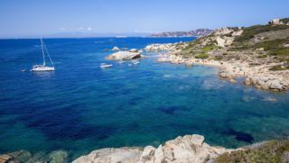 Italy, Sardinia, province of Olbia-Tempio, the Coast of Emerald (Costa Smeralda), Palau, Porto Cuncato, creek and beach of Talmone, the island of the Maddalena in background