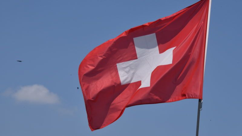 20 May 2018, Belgium, Malmedy: The Swiss flag flutters in the wind. · NO WIRE SERVICE · Photo: Horst Galuschka/dpa/Horst Galuschka dpa