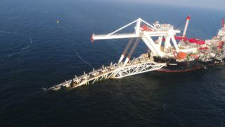 """07 November 2018, Mecklenburg-Western Pomerania, Lubmin: The pipeline laying vessel """"Audacia"""" is laying pipes for the Nord Stream 2 Baltic Sea natural gas pipeline on the Baltic Sea off the island of Rügen. Gazprom subsidiary Nord Stream 2 is pushing ahead with the construction of the Baltic Sea pipeline. The 1,200-kilometer-long gas pipeline is to transport around 55 billion cubic meters of Russian natural gas from Russia to Germany every year from the end of 2019. (Aerial photograph with a drone /opter) Photo: Stefan Sauer/dpa-Zentralbild/dpa"""