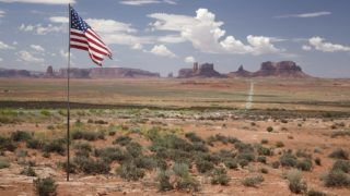 Monument Valley and Stars and Stripes - Arizona USA .    Biosphoto / Christophe Ravier