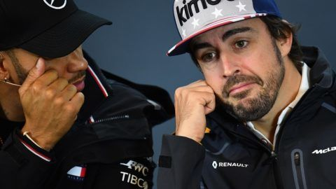 AUSTIN, TX - OCTOBER 18: Lewis Hamilton of Great Britain and Mercedes GP and Fernando Alonso of Spain and McLaren F1 talk in the Drivers Press Conference during previews ahead of the United States Formula One Grand Prix at Circuit of The Americas on October 18, 2018 in Austin, United States.   Clive Mason/Getty Images/AFP