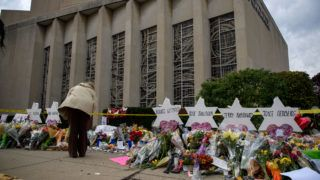 PITTSBURGH, PA - OCTOBER 31: Mourners visit the memorial outside the Tree of Life Synagogue on October 31, 2018 in Pittsburgh, Pennsylvania. Eleven people were killed in a mass shooting at the Tree of Life Congregation in Pittsburgh's Squirrel Hill neighborhood on October 27.   Jeff Swensen/Getty Images/AFP