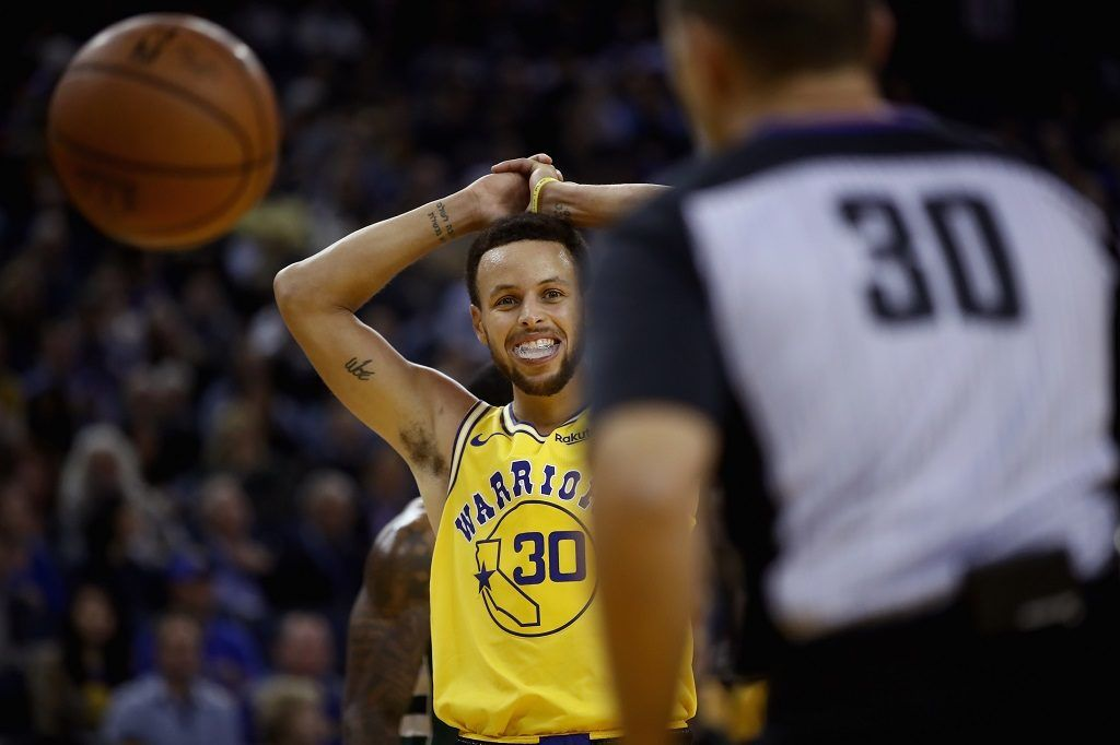 OAKLAND, CA - NOVEMBER 08: Stephen Curry #30 of the Golden State Warriors reacts after being called for a foul during their game against the Milwaukee Bucks at ORACLE Arena on November 8, 2018 in Oakland, California. NOTE TO USER: User expressly acknowledges and agrees that, by downloading and or using this photograph, User is consenting to the terms and conditions of the Getty Images License Agreement.   Ezra Shaw/Getty Images/AFP