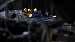 PARADISE, CA - NOVEMBER 22: Search and rescue crews search a property that was destroyed by the Camp Fire for human remains on November 22, 2018 in Paradise, California. Fueled by high winds and low humidity the Camp Fire ripped through the town of Paradise charring over 150,000 acres, killed at least 83 people and has destroyed over 18,000 homes and businesses. The fire is currently at 85 percent containment and hundreds of people still remain missing.   Justin Sullivan/Getty Images/AFP