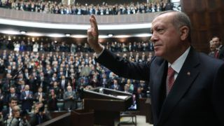 ANKARA, TURKEY - NOVEMBER 27: President of Turkey and leader of Turkey's ruling Justice and Development (AK) Party Recep Tayyip Erdogan greets the crowd during his party's parliamentary group meeting at the Grand National Assembly of Turkey in Ankara, Turkey on November 27, 2018. Cem Oksuz / Anadolu Agency