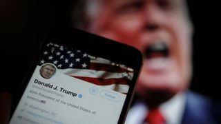 The Twitter app is seen with an image of US president Donald Trump in the background in this photo illustration on December 4, 2017. (Photo by Jaap Arriens/NurPhoto)