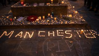 Candles, as a tribute for the victims of the Manchester Arena attack, in Manchester, United Kingdom, Monday, May 29, 2017. Greater Manchester Police are treating the explosion, which has killed 22 people, after the Ariana Grande concert, which took place on 05/22/2017 at Manchester Arena, as a terrorist incident. (Photo by Jonathan Nicholson/NurPhoto)