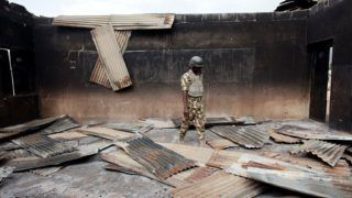 WEDNESDAY, April 8- GWOZA, NIGERIA: A soldier walks through a destroyed classroom at the UBE (Universal Basic Education) Junior Secondary School in  Gwoza, Nigeria, the former base of Boko Haram, recently retaken by the Nigerian military.  (Jane Hahn for the Washington Post)